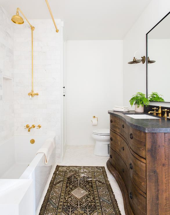 transitional bathroom with gold fixtures and shower curtain rail
