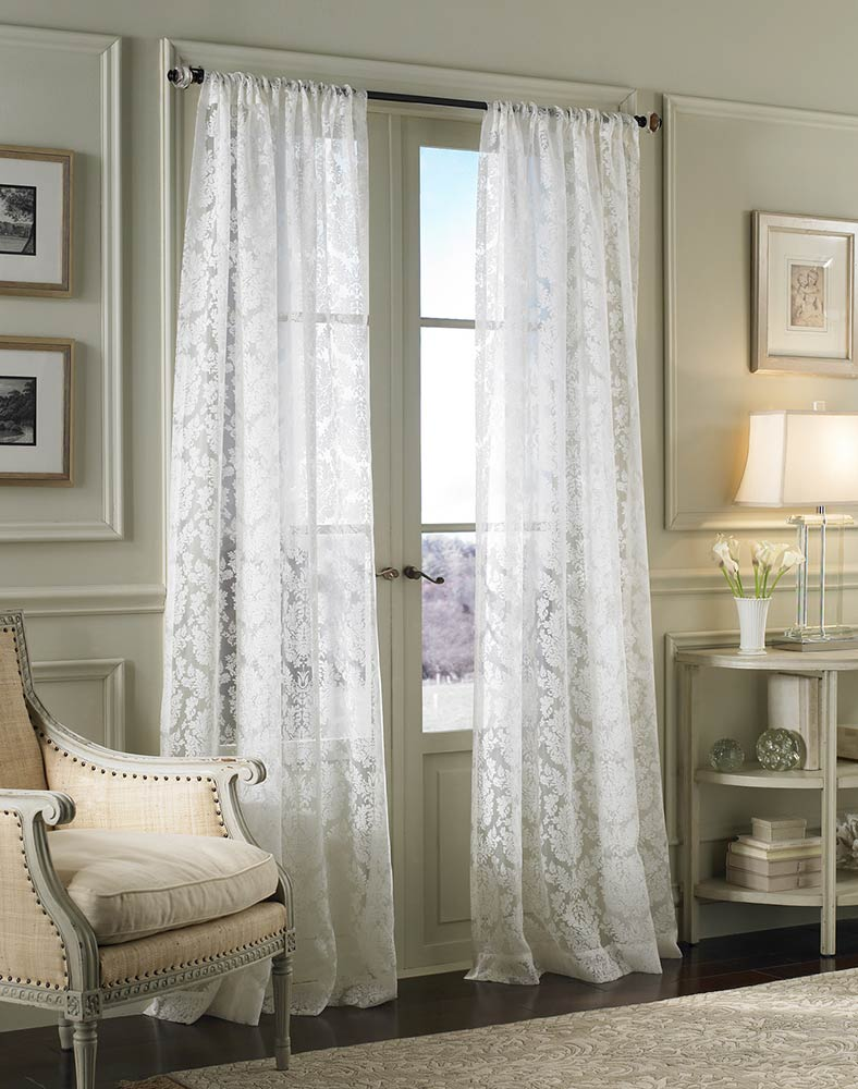 white lace curtains in chic sitting room