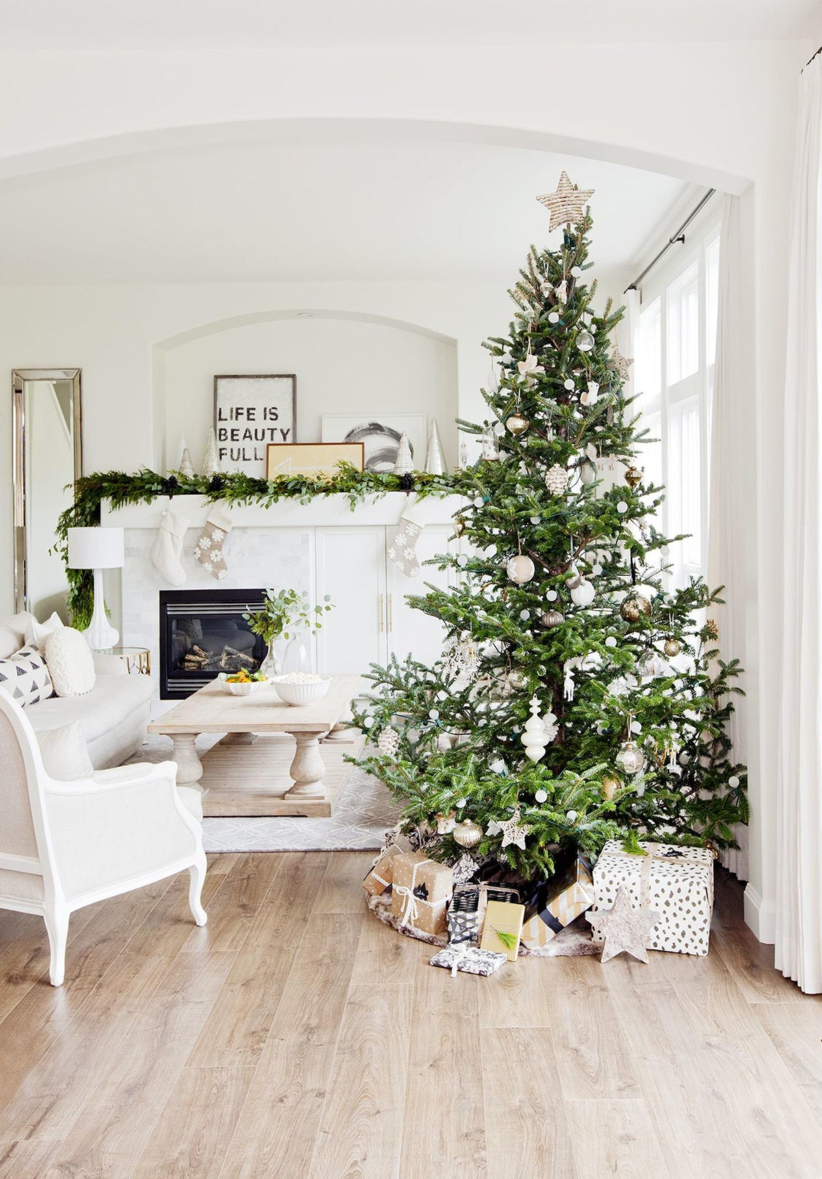 white interior with green Christmas tree and metallic curtain rod brackets