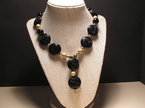 N-007/BLACK ROUNDS AND GOLD BEADED NECKLACE