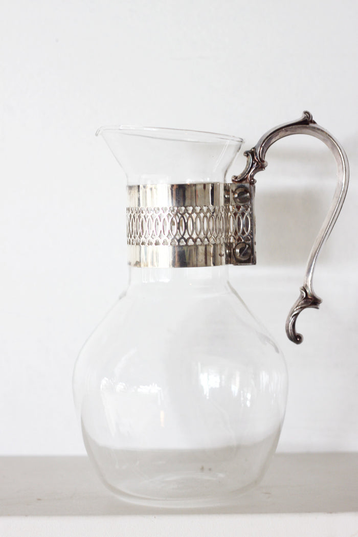 Vintage glass pitcher with silver handle