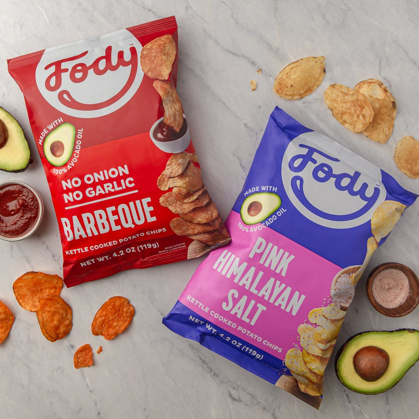 fody low fodmap bbq chips and fody low fodmap pink himalayan salt kettle chips with 2 avocado halves