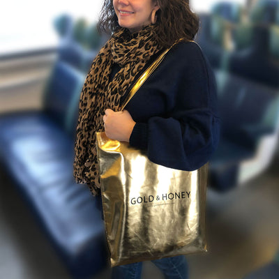 Gold tote bag on shoulder