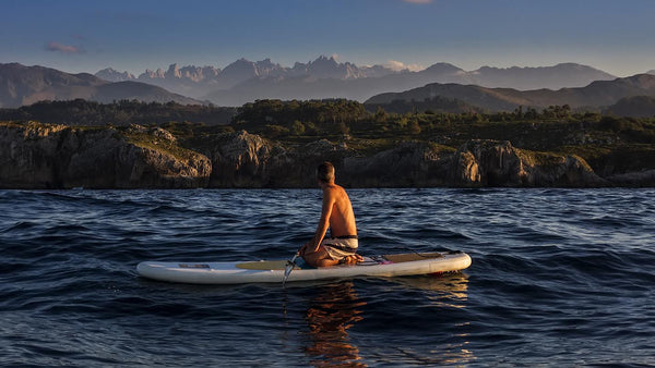 Man Stand Up Paddle Boarding in Austurias Spain