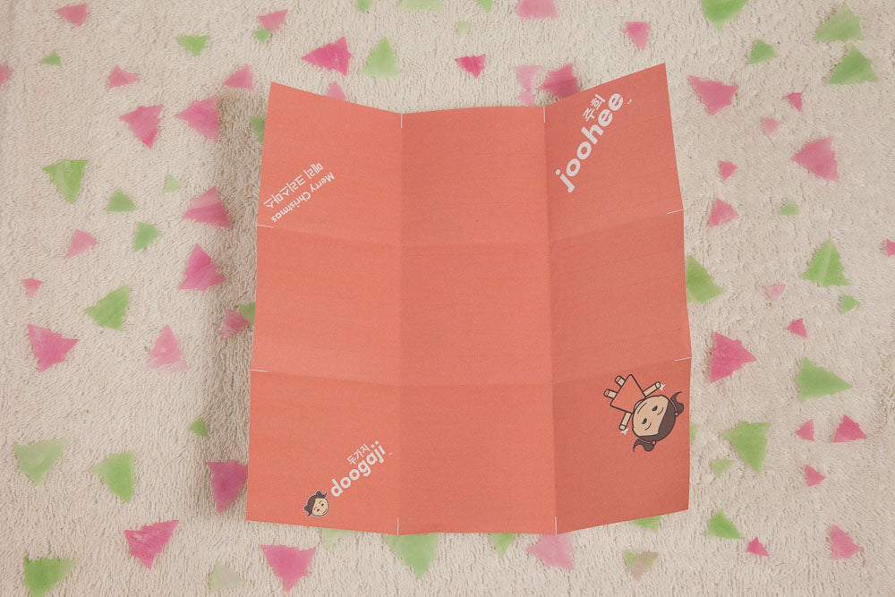 Step 3: Fold on the thirds both ways, using the white markers as guides, then lay the paper open.
