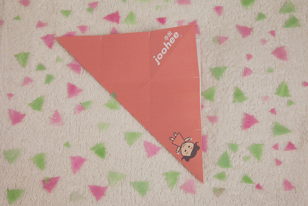 Step 4: Fold diagonally both ways, then lay the paper open.