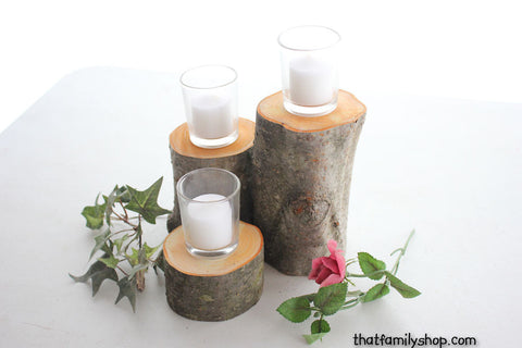 three logs on a table, centerpiece display candle holder