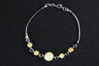 Sterling silver bracelet with white Baltic amber stones