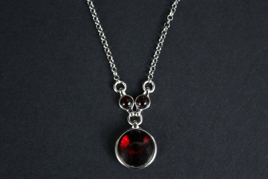 Sterling silver necklace with cherry amber stone