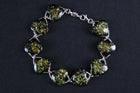 Sterling silver bracelet with green Baltic amber stones