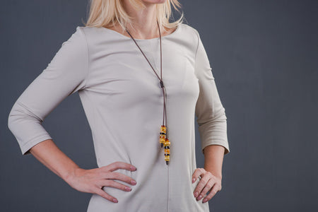 "Baltic amber multicolor necklace with leather chain ""Bee"""