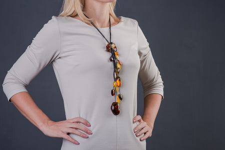 "Baltic amber multicolor necklace with leather chain ""Glance"""