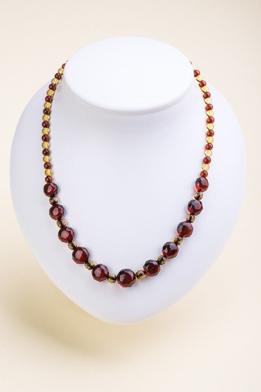 "Polished faceted beads Baltic amber necklace ""Glimpse"""