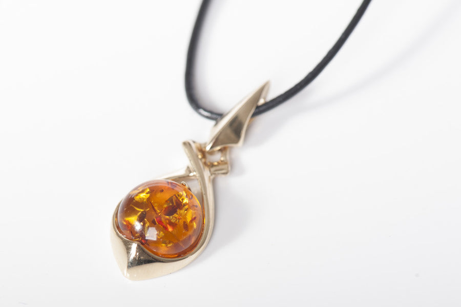 "Gold pendant with amber stone ""Element"" cognac"