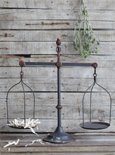 This rustic vintage-inspired metal scale is a must have for any modern farmhouse style home! Its details are a reminder of days gone by. We love how versatile it is too - whether you want to use it as the centerpiece of a decorative vignette or you want to store soaps and hand towels in the bathroom, it works WONDERFULLY. This is an item that can travel from room to room and get use all over your home!