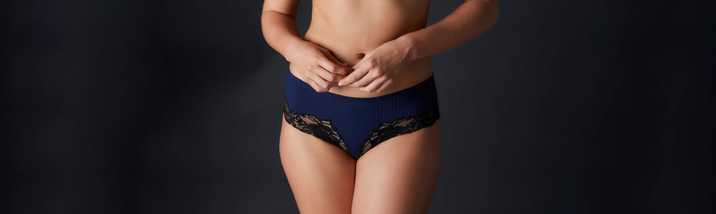 Woman wearing Noelle Wolf Lissom Bra with black lacy cups