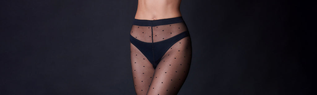 Woman wearing the Wolford black floral lace Morgan Tights