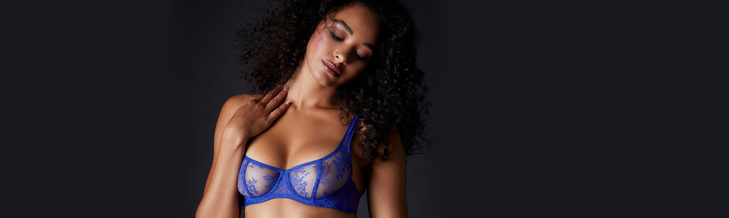 Woman wearing Blue romy demi bra lingerie