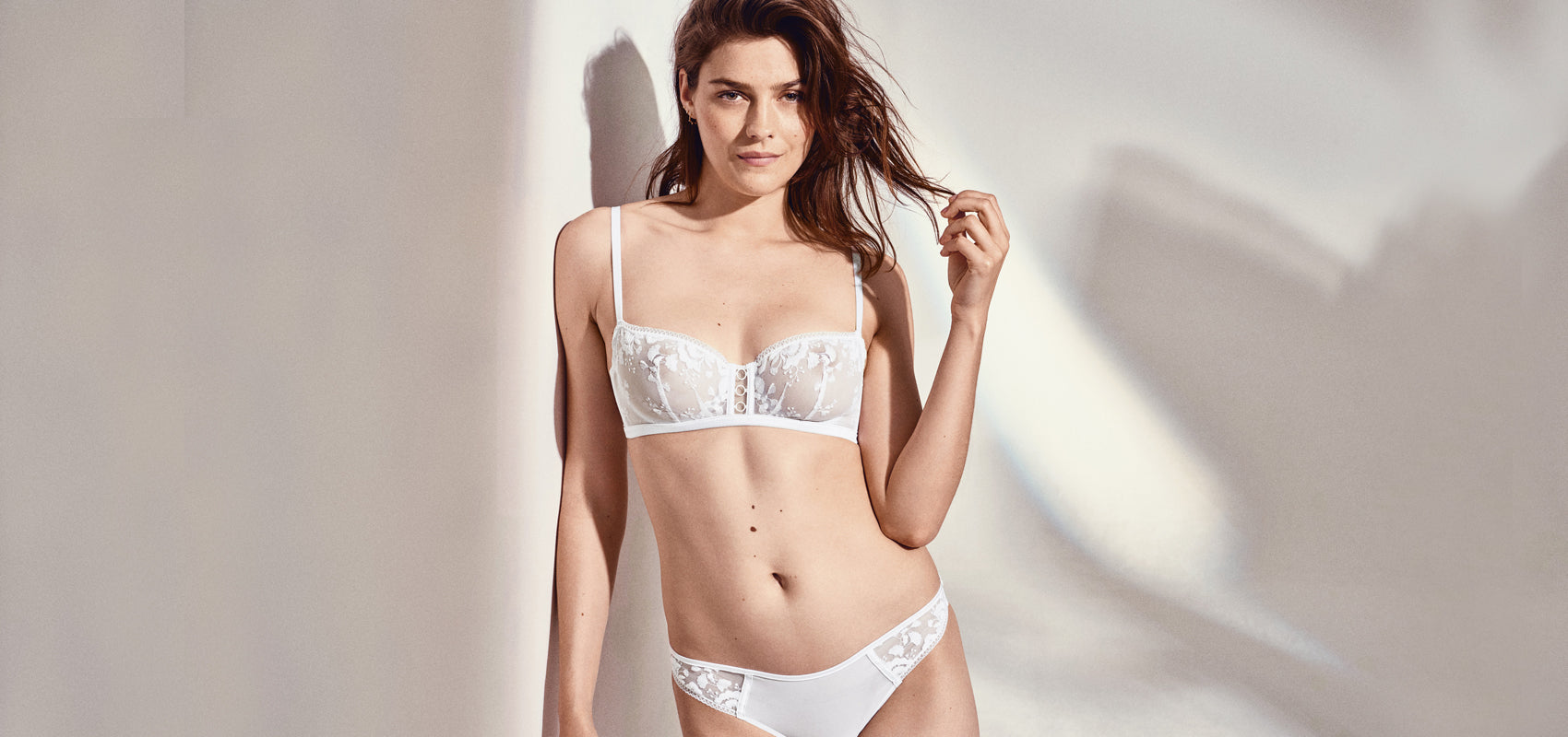 Woman wearing white lingerie bra and brief