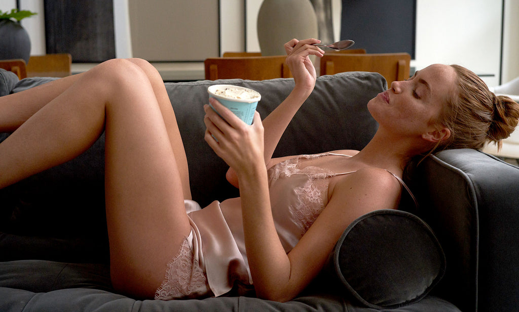 Woman wearing the Journelle luxury silk loungewear Charlotte Camisole and Tap Short