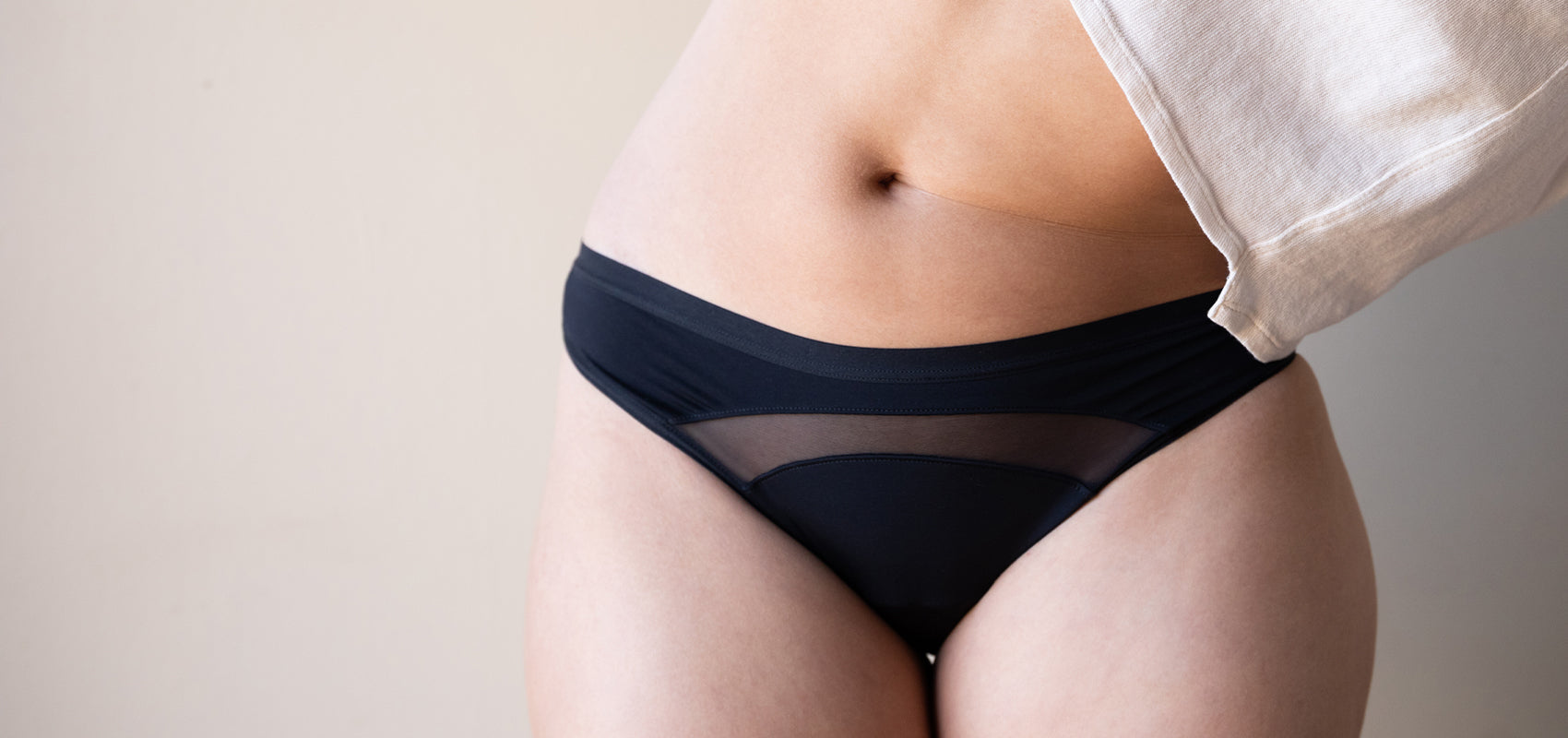 Woman wearing black brief with mesh panel