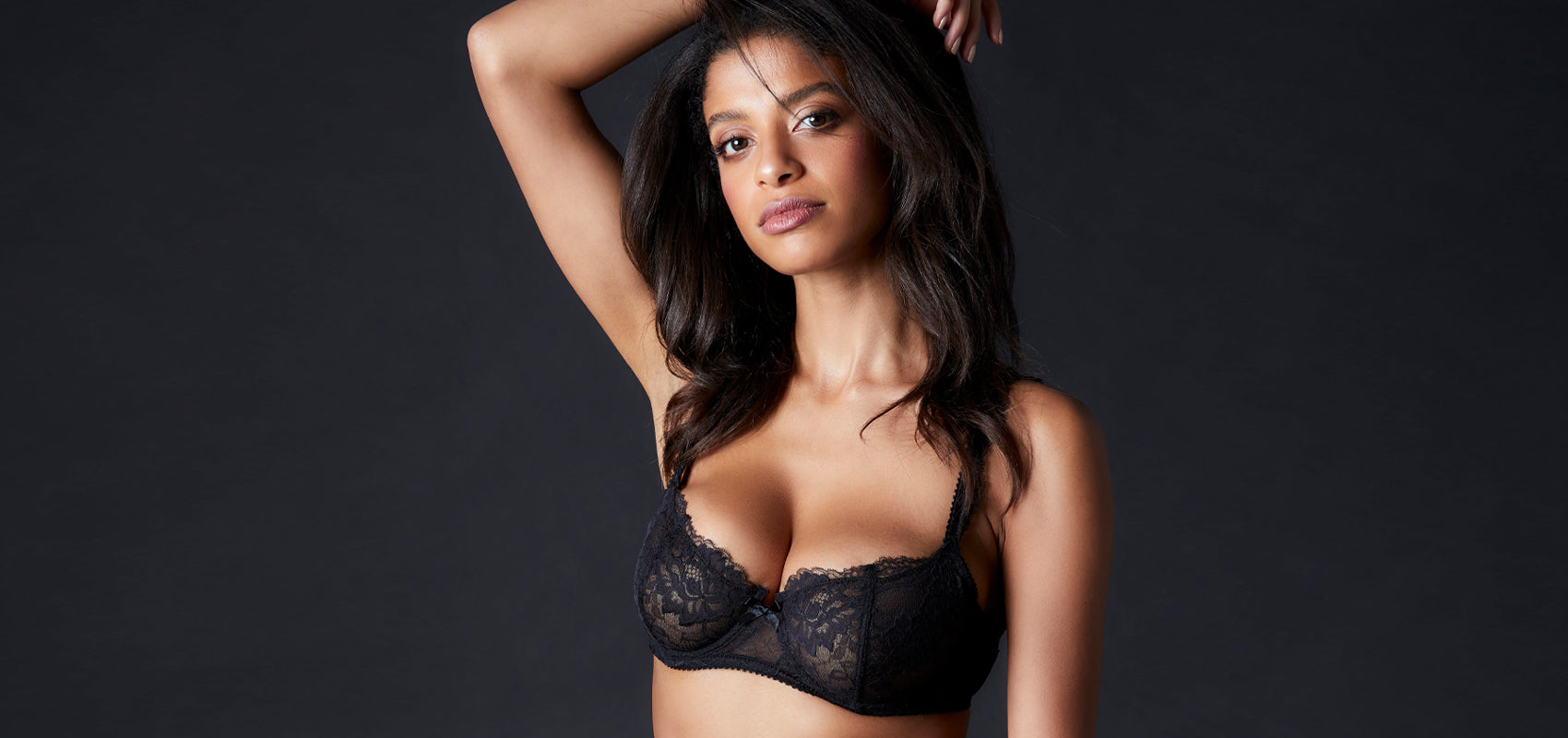 Woman wearing Journelle Collection Isabel Balconette Bra in black lace.