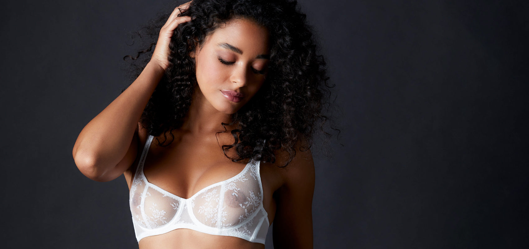 Woman wearing Journelle Collection Romy Demi Bra in white lace.