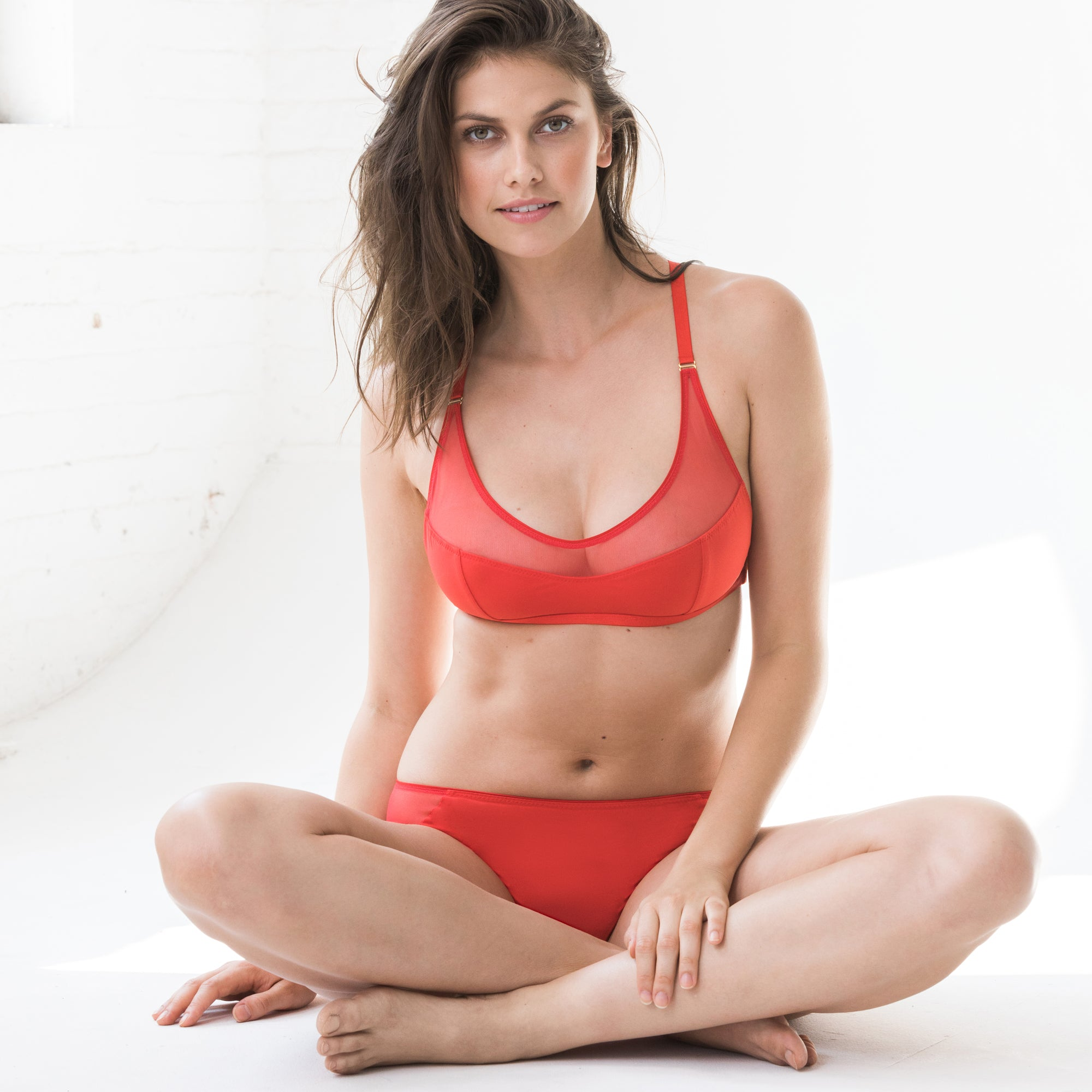 Lyn Lingerie  Lue Bandeau Soft Cup Bra This utterly gorgeous tulle and modal soft bra, with luxurious Swiss embroidery, killer back details, and brilliant red palette is a glorious nod to peek-a-boo perfection. Go on, show it off. We dare you.