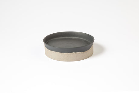 Dark grey porcelain plate with concrete bottom