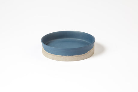 Blue porcelain plate with concrete bottom