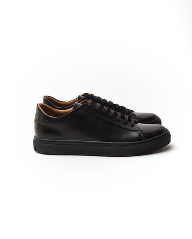 Low top black leather sneakers