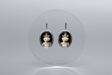 """Worthy of admiratio"" teddy silver earrings"