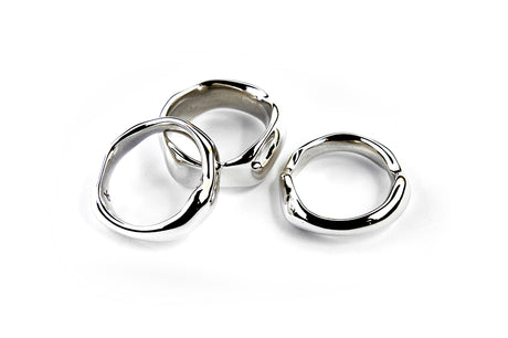 A set of 3 highly polished sterling silver free form Ice Rings