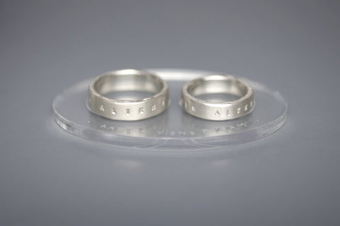 Silver wedding rings with inscriptions in Latin