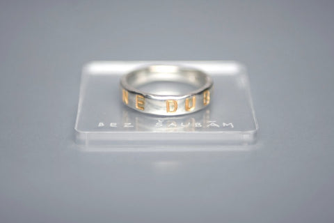 Silver ring with gold plated inscription in Latin