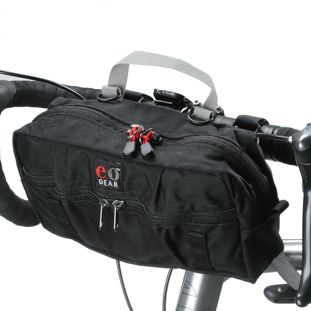 Pack attached to a bike, illustrating the sewn-in hand grab loop.
