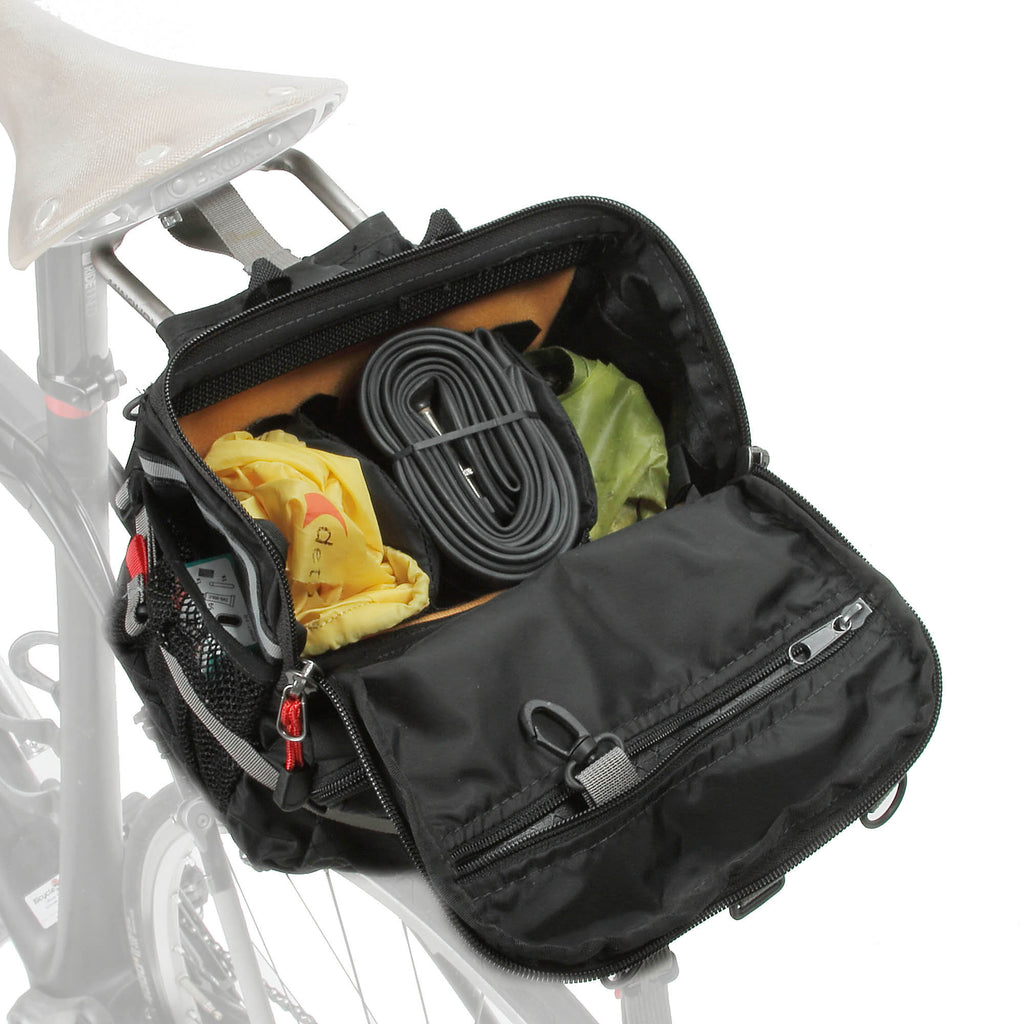 "The main ""reverse opening"" lid opens away from the saddle or handlebars. Dividers keep gear separate. Snaphook inside the zippered lid pocket is for keys."
