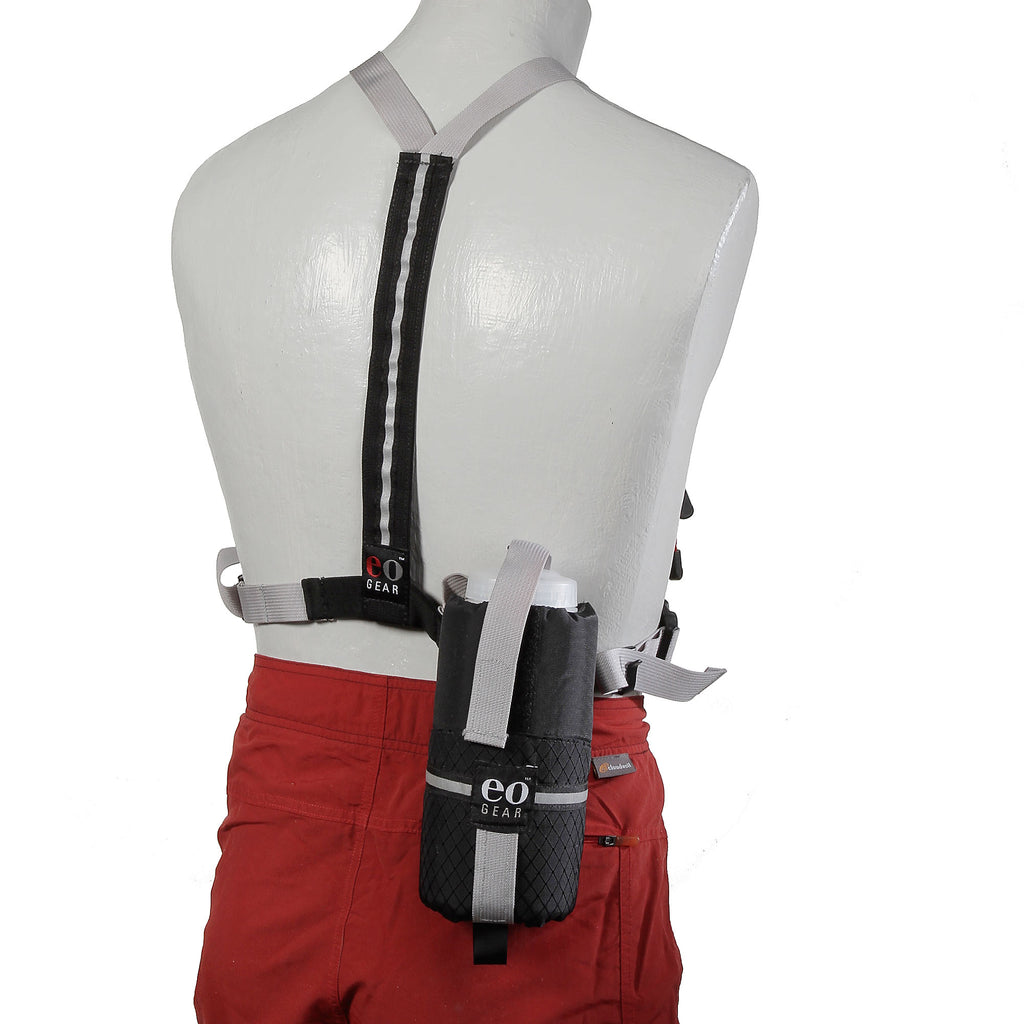 The 0.8 Bottle Pouch (or any other pouch with dual tabs on the back) can be attached to the rear of the harness for extra capacity.
