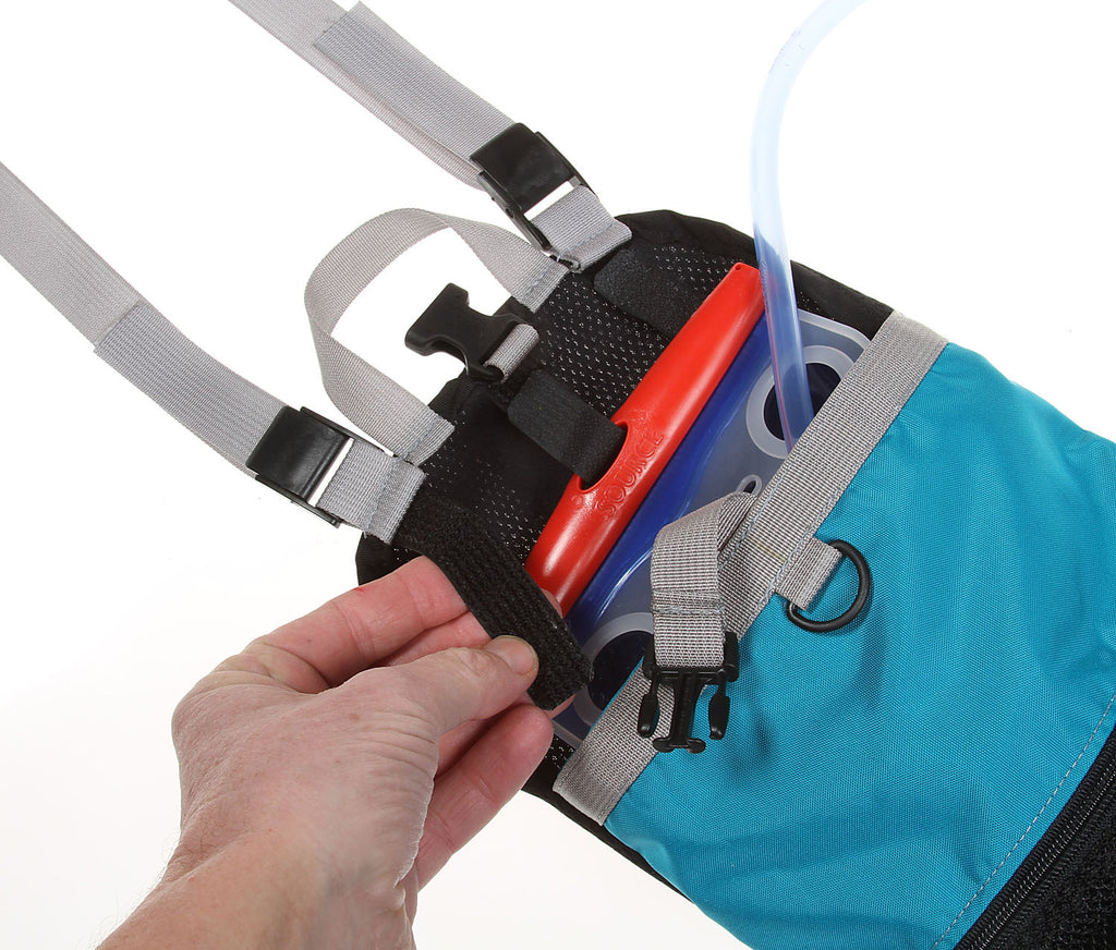 The rear module has three hook & loop straps for attaching to various bladders, keeping it near the top of the pack.