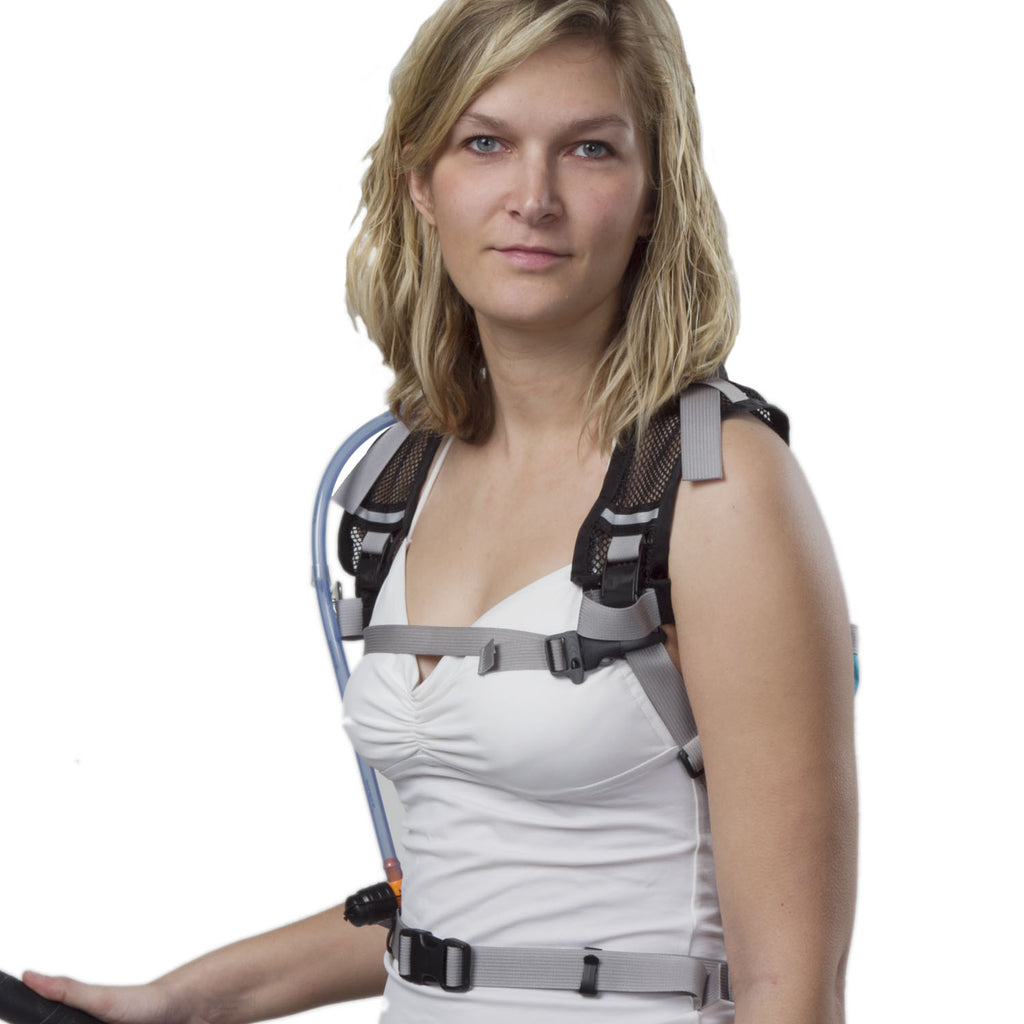 The harness features a sternum strap, but waist belt shown is part of the rear module.