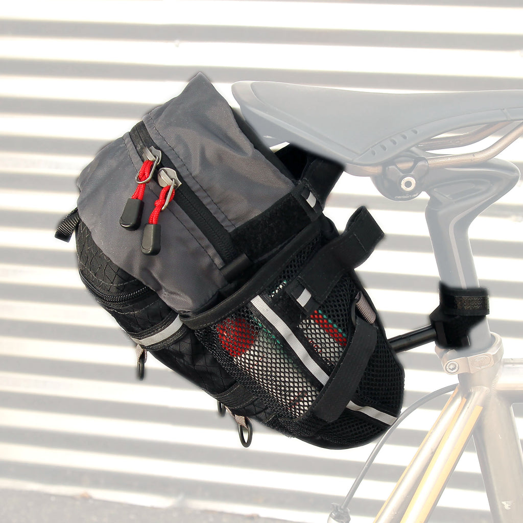 "The bag attaches with two Velcro straps around the rails of the saddle and a third attachment point around the seatpost. Shown is the ""upper"" pair of straps which is preferred. The lower set is only for smaller frames."