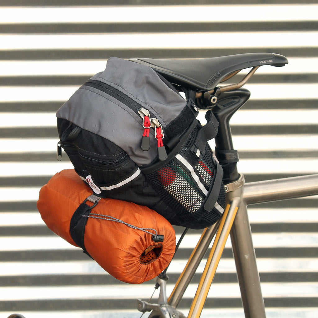 Optional accessories, like this 2L stuff sack (for a jacket) or a spare tire can be attached to the outside.