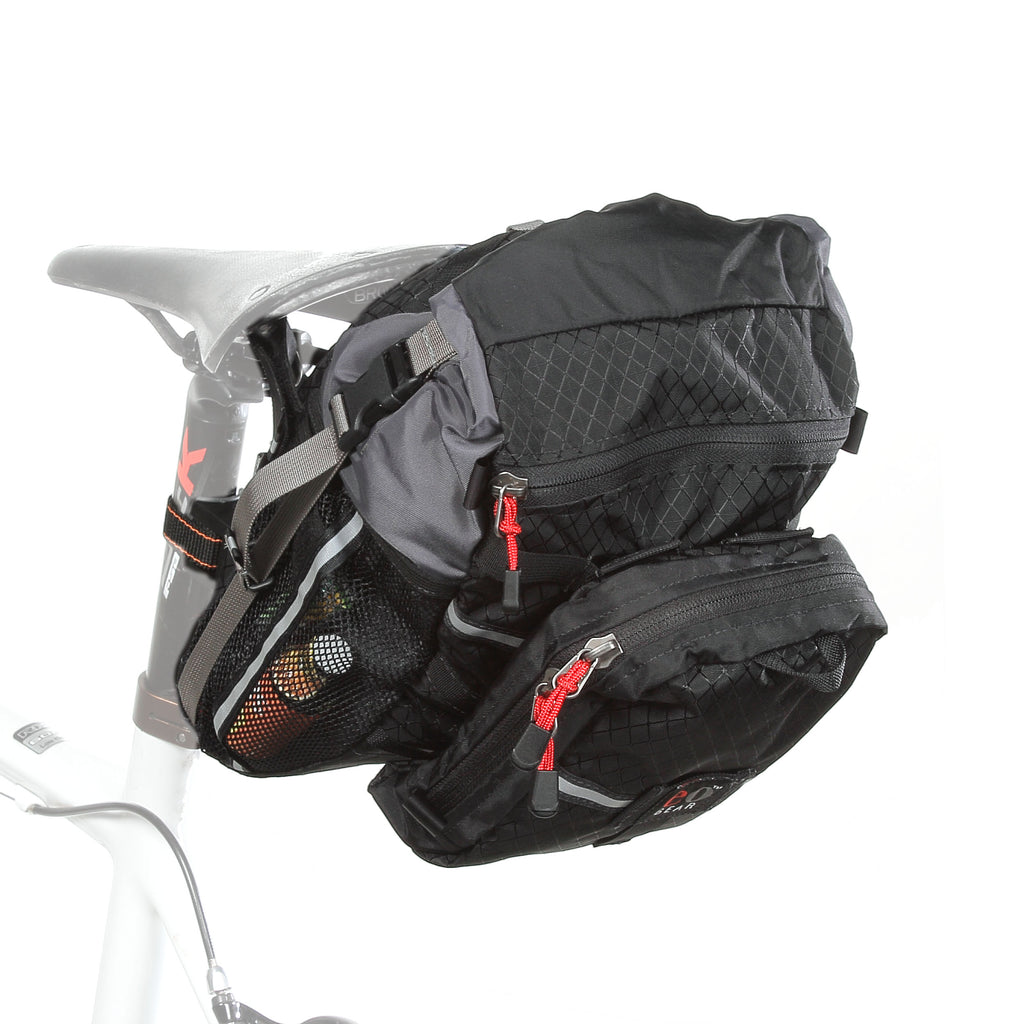 The optional Piggy-back Pocket 2.5 can be added to the back for additional capacity. It attaches in four points. When attaching it, your bag to tire clearance will be decreased.