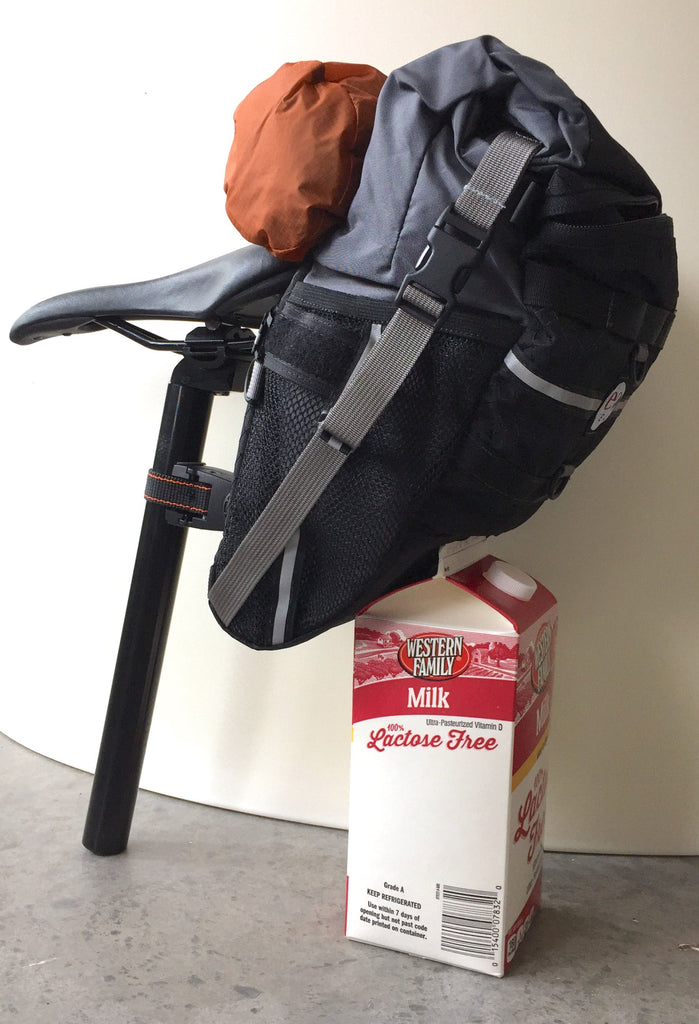 Per the request of a customer, this reference photo: 9.0 bag & a 1/2-gal milk. The 10.0 is similar in size except the 10.0 uses a different seatpost adapter.