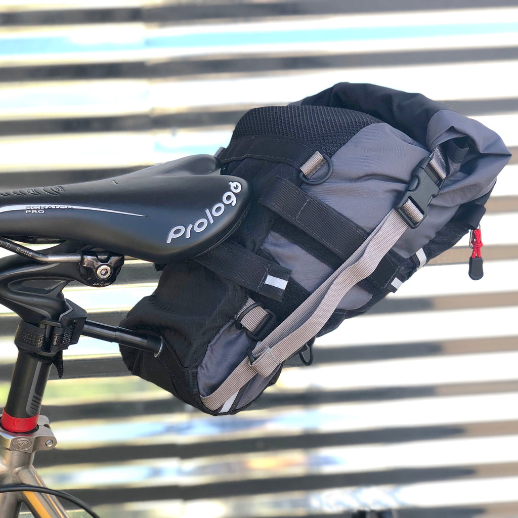 Bag shown attached as if on a small bicycle frame, using the bottom set of Velcro rail straps. The bottom of the bag is compression using built-in Velcro-like straps.
