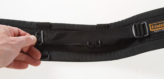 Insert as shown with the slider flipped so it is underneath the fold of the webbing. Bowing the belt helps provide the necessary slack. Also visit our How To page for more details on using metal slider Twin Buckle system.