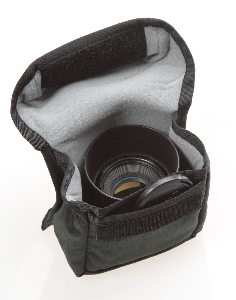 The front slip pocket of the F102 holds lens caps (pouch interior is now orange colored)