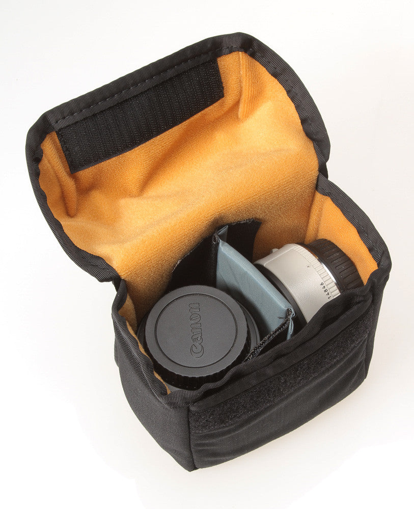 The V020 divider (now in black) attaches to one side of the pouch for two very small lenses or teleconverters.