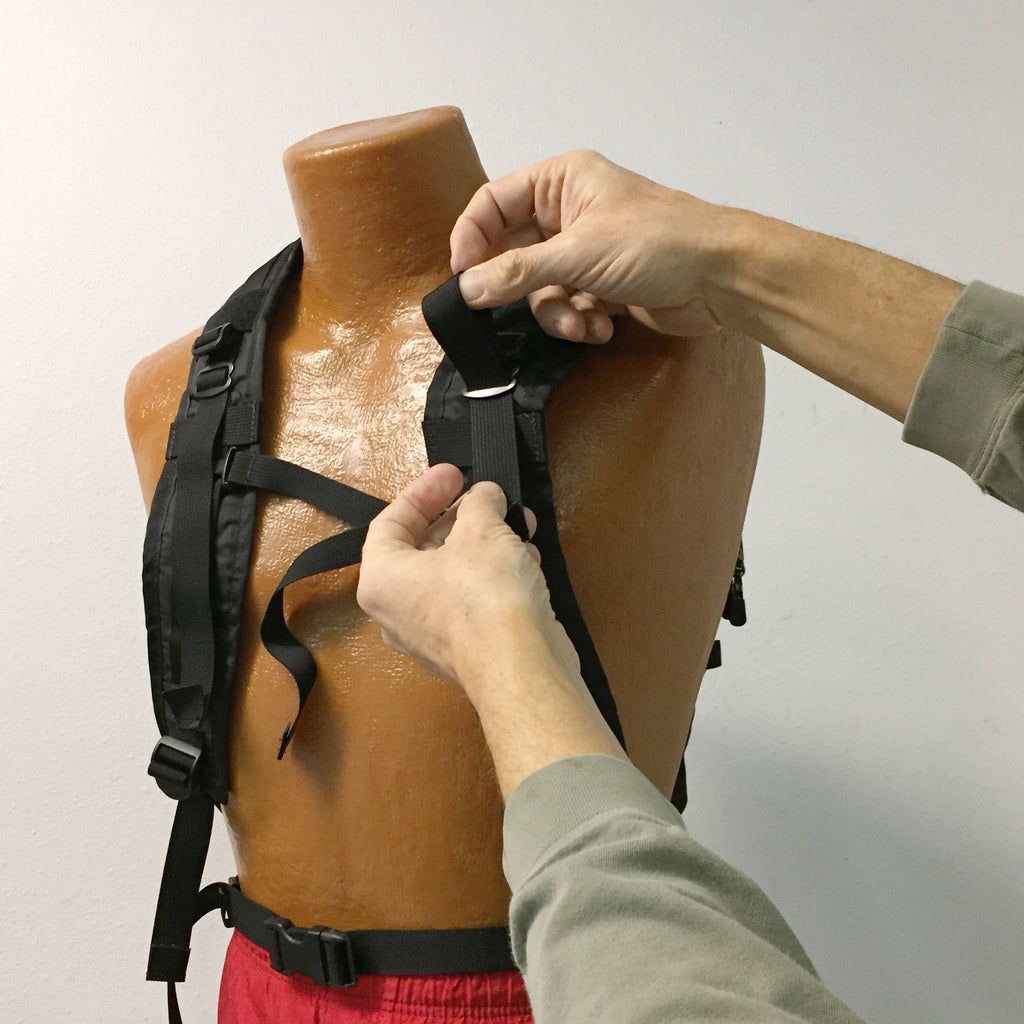 How to feed the top strap through the sliders on the harness.