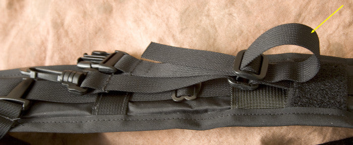 Detail showing how to double back the webbing.